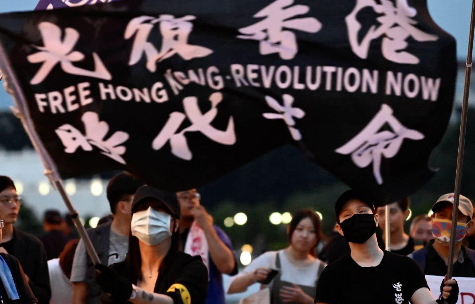 Une manifestation en appui aux mouvent pro-démocratie hongkongais à Taipei, samedi. De plus en plus de Hongkongais songent à s'exiler de l'ancienne colonie britannique.