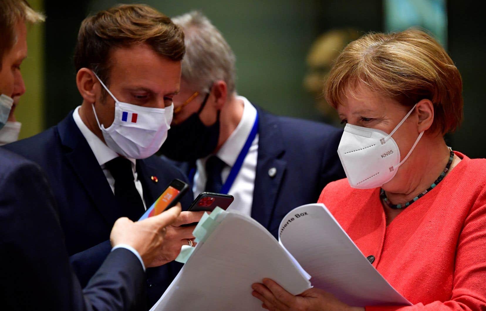 Les tensions étaient palpables entre le couple franco-allemand, Emmanuel Macron et Angela Merkel (notre photo), d'un côté et les pays dit «frugaux» de l'autre.