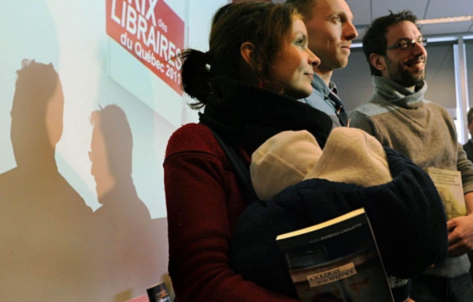 Les finalistes des 18es Prix des libraires du Québec ont été dévoilés hier à la Grande Bibliothèque. Ci-dessus, trois des auteurs toujours en lice: la réalisatrice Anaïs Barbeau-Lavalette (ici avec son petit Manoé dans les bras), Nicolas Langelier et Jean-Simon DesRochers. Le gagnant sera dévoilé le 9 mai.