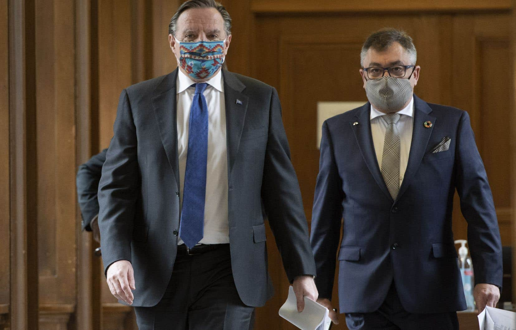 Le premier ministre François Legault et ledirecteur national de santé publique, Horacio Arruda