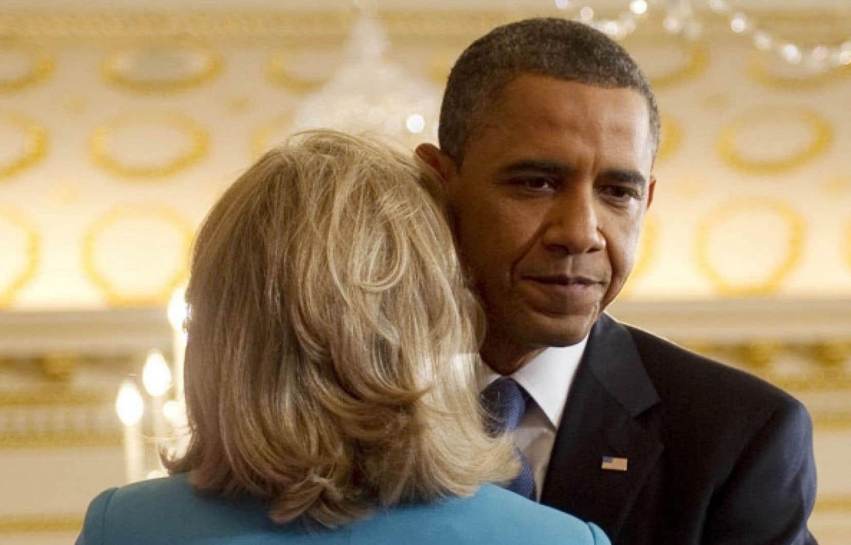 Le président américain, Barack Obama, en compagnie de la secrétaire d'État Hillary Clinton à l'issue de son discours hier à Washington.