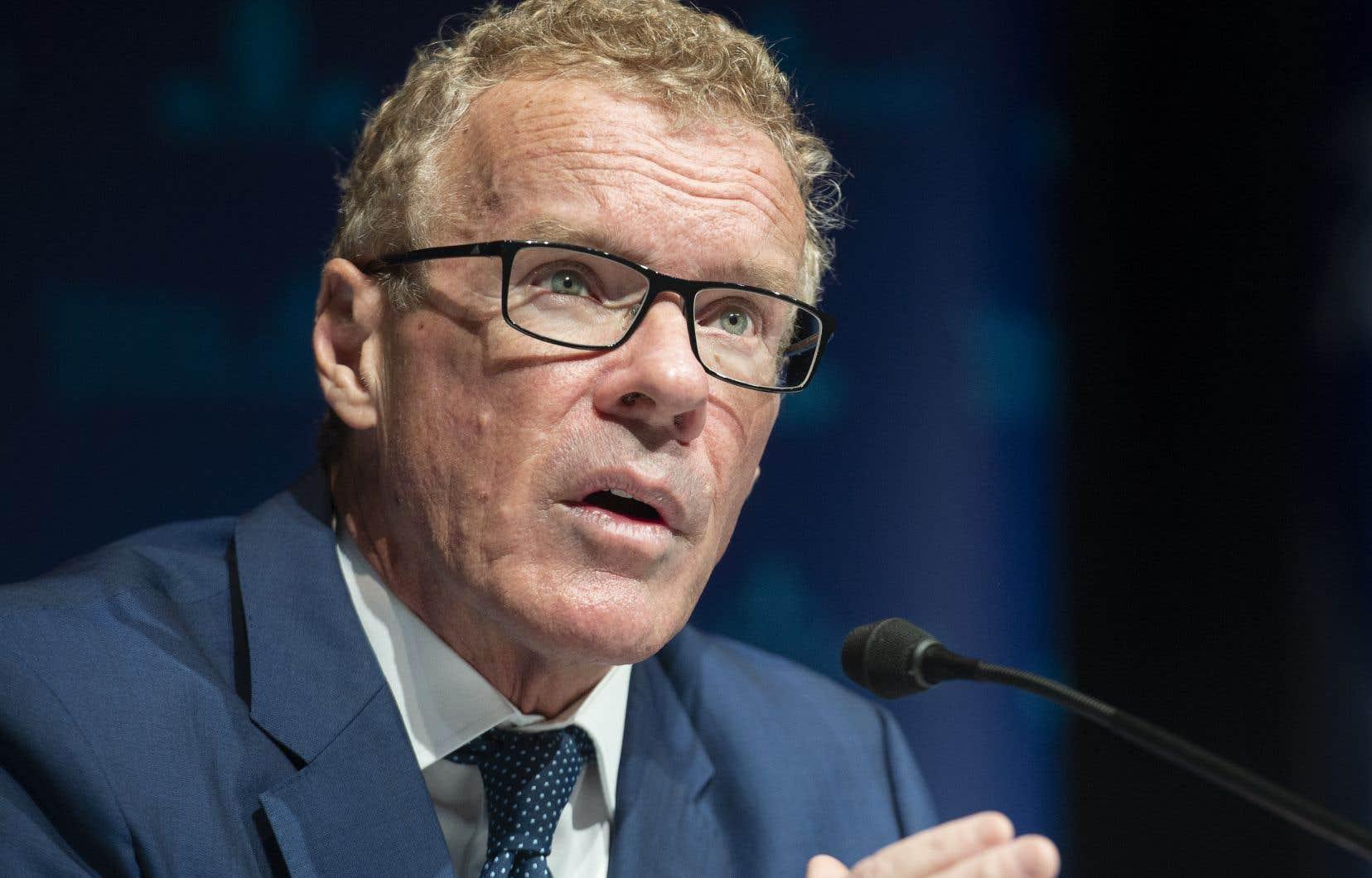 Le ministre du Travail, de l'Emploi et de la Solidarité sociale, Jean Boulet