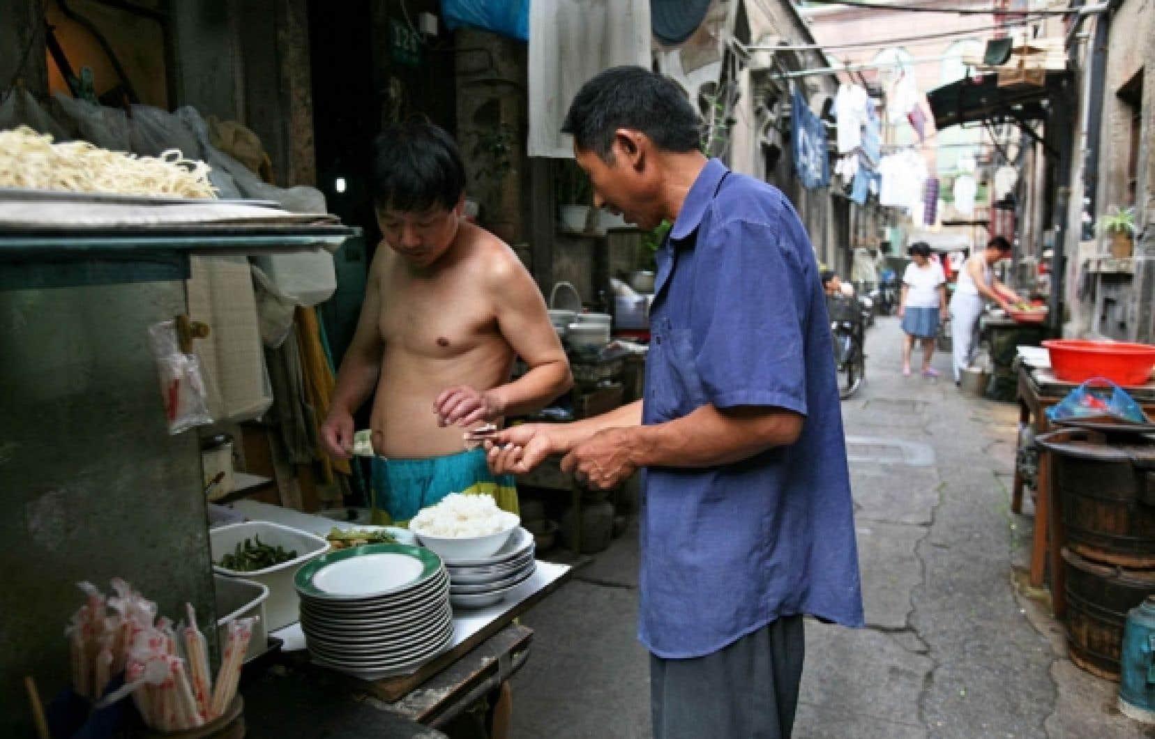 En Chine, certains produits alimentaires ont un prix en partie fixé par le gouvernement, notamment le riz et les céréales.<br />