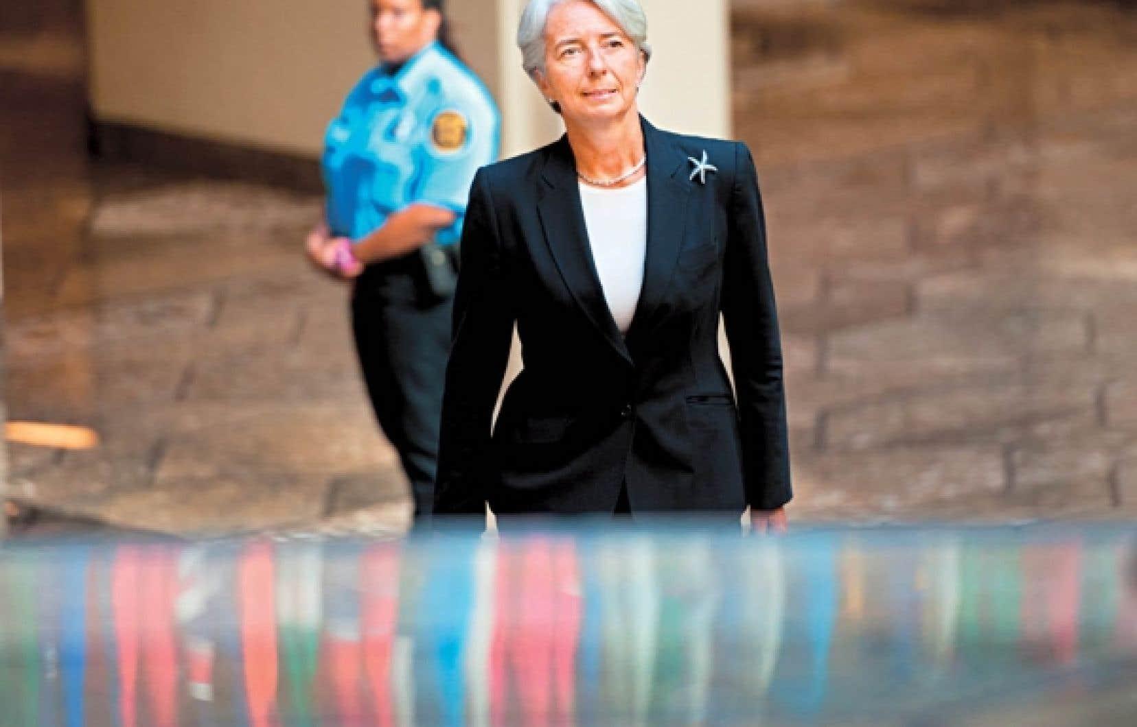 Christine Lagarde à son arrivée dans son nouveau lieu de travail, le FMI, à Washington.<br />