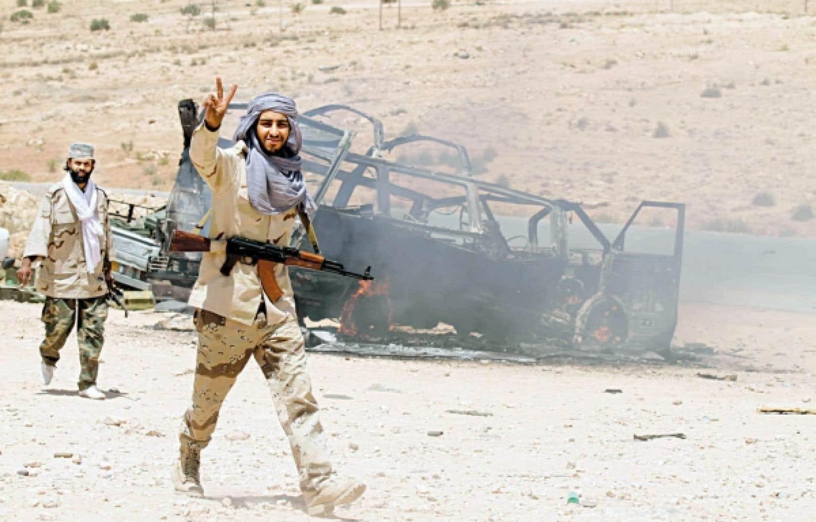 Un combattant rebelle hier peu après la prise d'al-Kaoualich