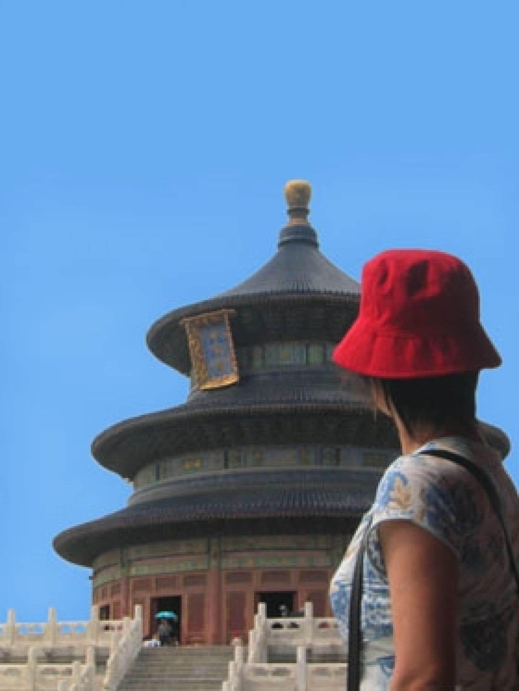 La Pékinoise Ping regarde «son» temple du Ciel. Photo: Benoit Legault
