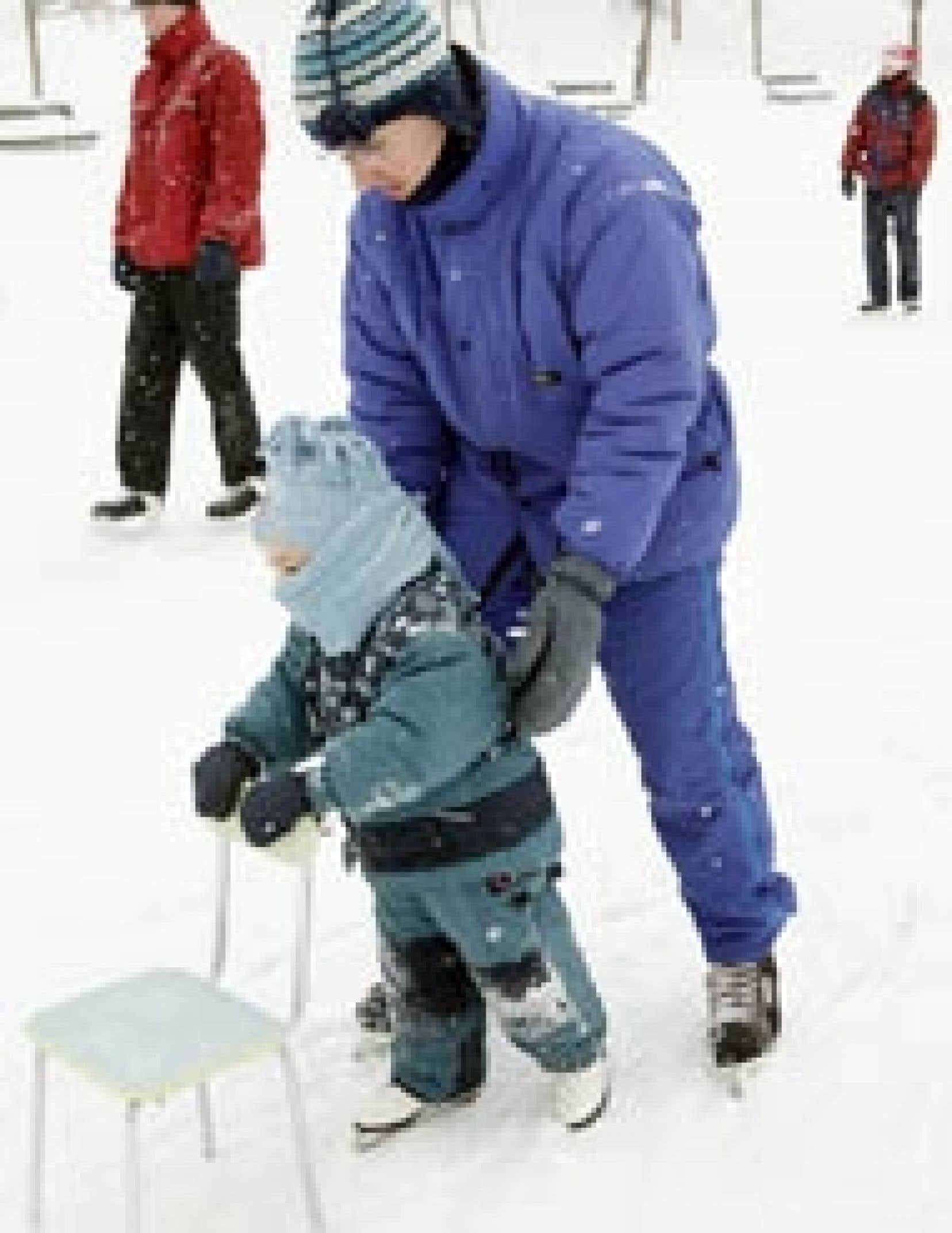 Les températures agréables d'hier, après une vague intense de froid, ont incité ce père de famille à initier son bambin aux joies du patin au parc Lafontaine.