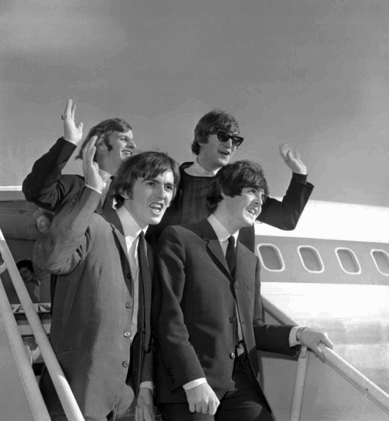 Les Beatles arrivent à l'aéroport de San Francisco le 18 août 1964.