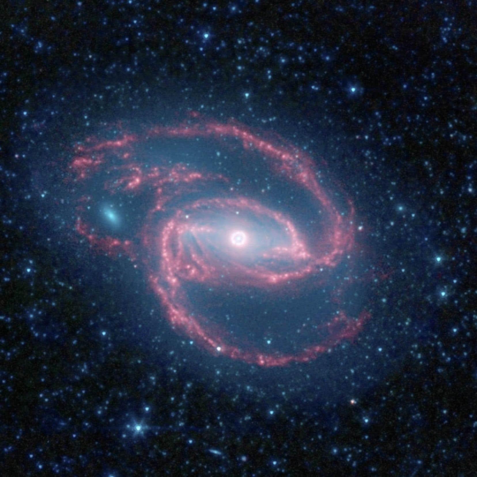 Une image de la galaxie NGC 1097, qui présente une forme semblable à celle de la Voie lactée.<br />