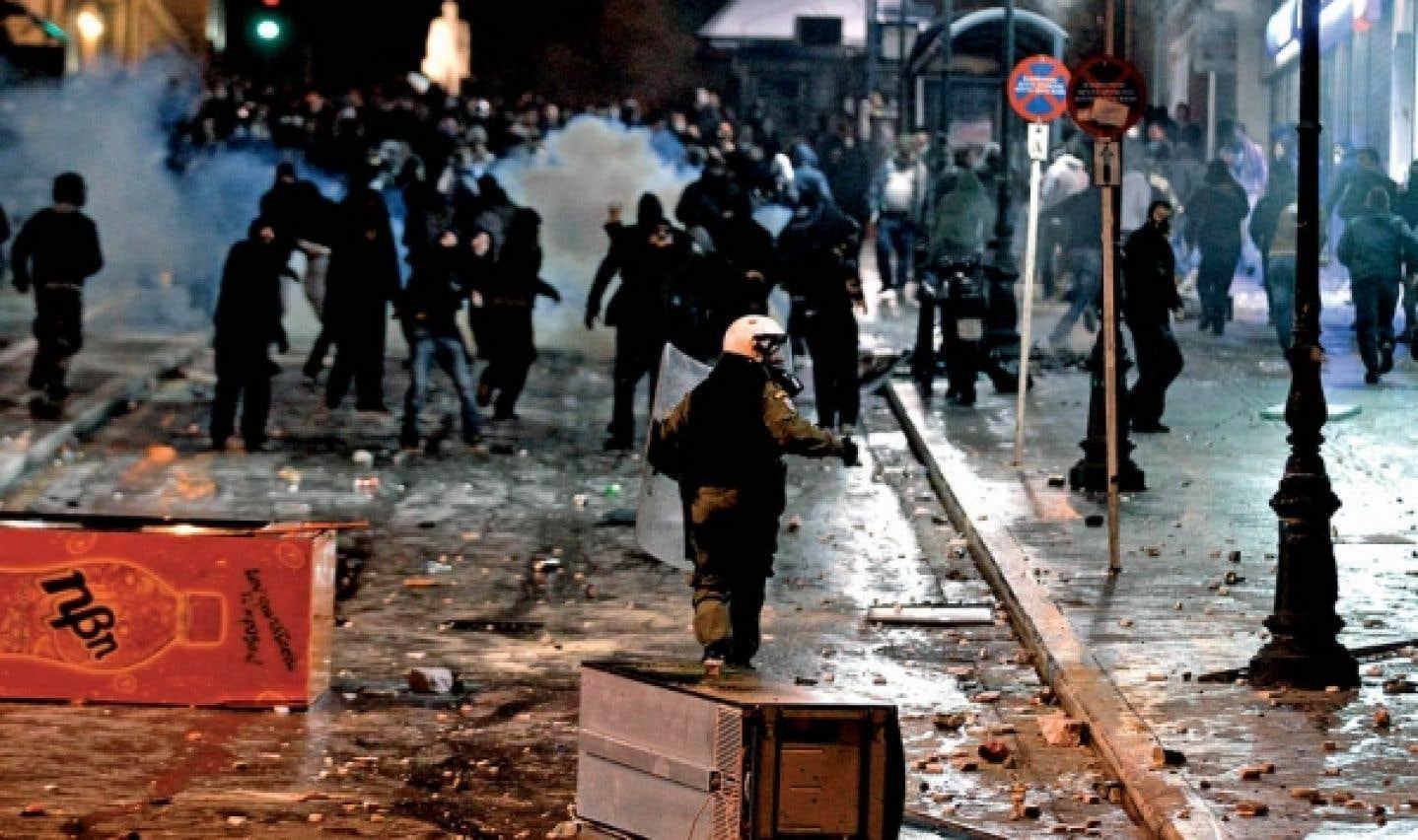 Crise de la zone euro - Le plan grec voté sur fond d'émeutes