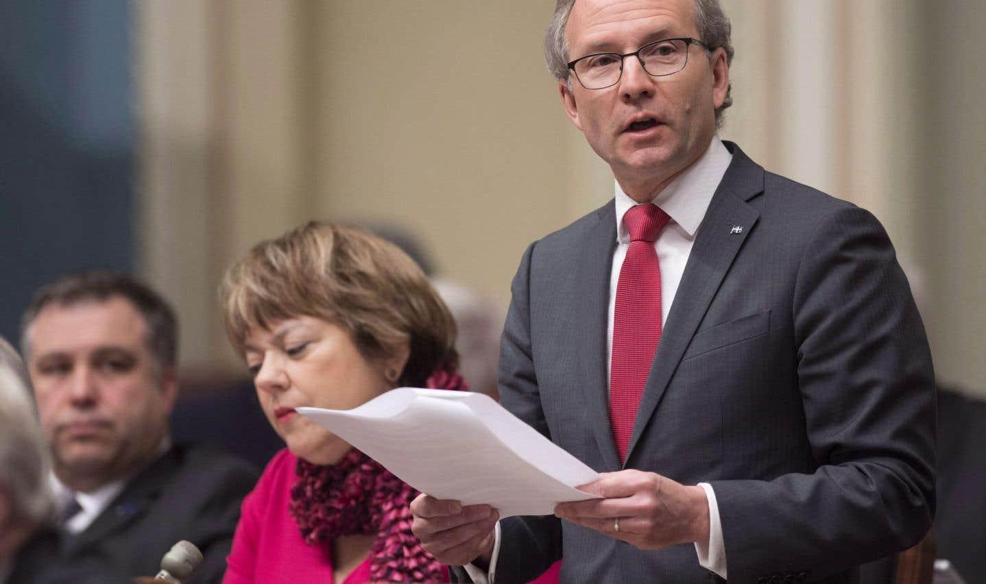 Le ministre Coiteux veut éviter la surenchère sécuritaire