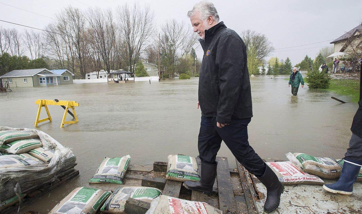 L'aide aux sinistrés augmentera, promet Couillard