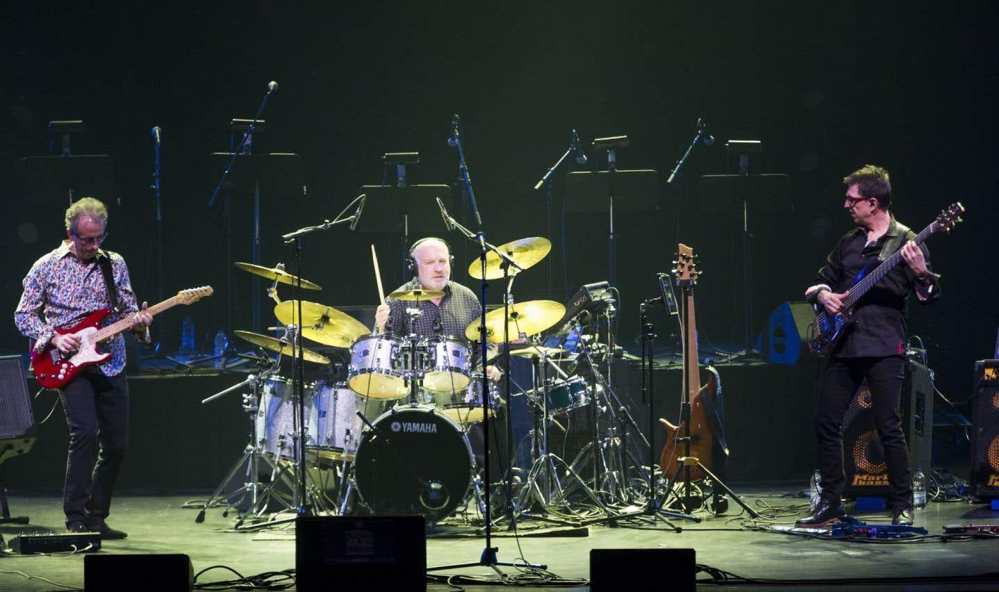 Michel Cusson à la guitare, Paul Brochu à la batterie etAlain Caron à la basse