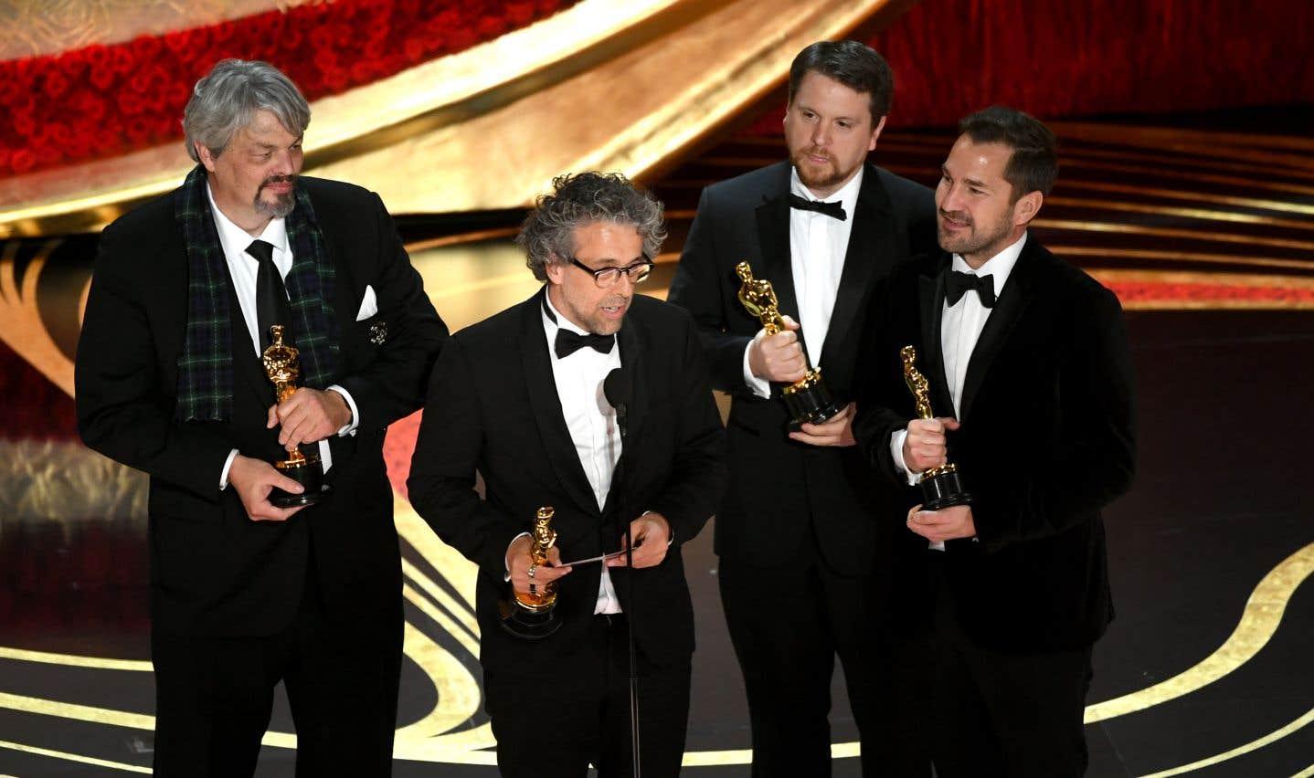 Ian Hunter, Paul Lambert, Tristan Myles, et J. D. Schwalm de l'équipe du film «First Man» ont reçul'Oscar pour les meilleurs effets spéciaux.
