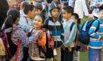 Les élèves de l'école primaire Garneau, à Montréal, attendent d'entrer en classe.