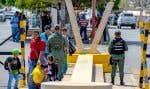 Des citoyens vénézuéliens sont rentrés au pays récemment au poste-frontière de Paraguachon.