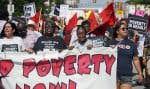 Plusieurs manifestations se sont déroulées dans les rues de Cleveland lundi, première journée de la convention du Parti républicain. Sur notre photo, une manifestation contre la pauvreté, la violence et le racisme, endémiques dans cette ville de l'Ohio.