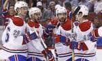 Le défenseur du Canadien de Montréal Andrei Markov (79) célèbre un filet marqué contre les Coyotes de Phoenix avec, entre autres, le défenseur Jeff Petry (26).
