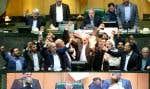 Des députés brûlent un drapeau américain au parlement iranien au lendemain de l'annonce du président Donald Trump du retrait des États-Unis de l'accord nucléaire.
