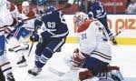 Carey Price s'est dressé à plusieurs occasions contre la puissante attaque des Maple Leafs, mercredi, notamment devant l'attaquant Tyler Ennis.